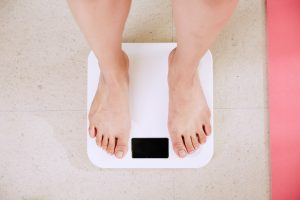 person stepping on the scale